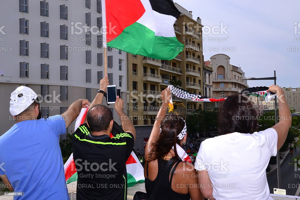 Protesters gather with Palestinian flag during a demonstration stock photo