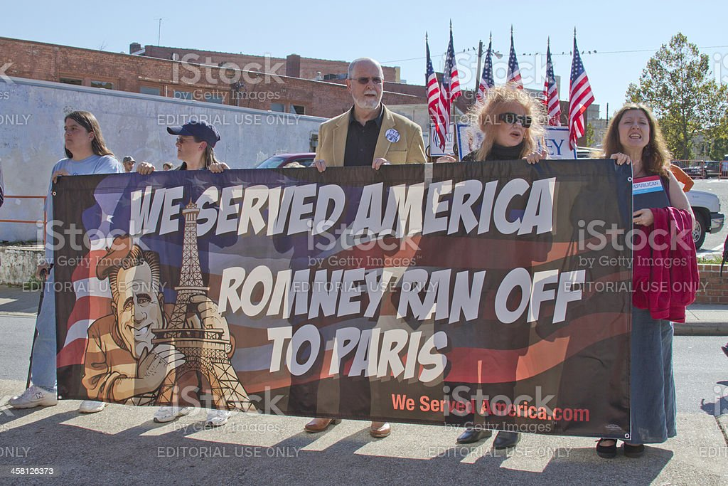 Protesters Hold Anti Romney Sign at Rally in Asheville, NC stock photo