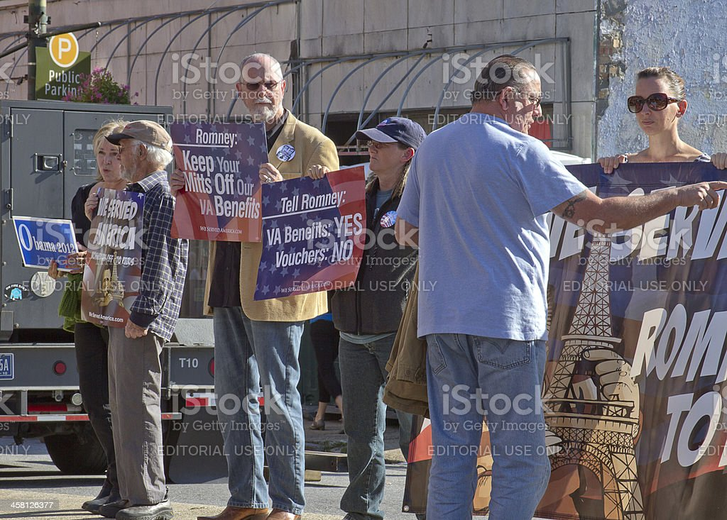 Protesters Hold Signs Protesting Mitt Romney's Medicare Policy stock photo