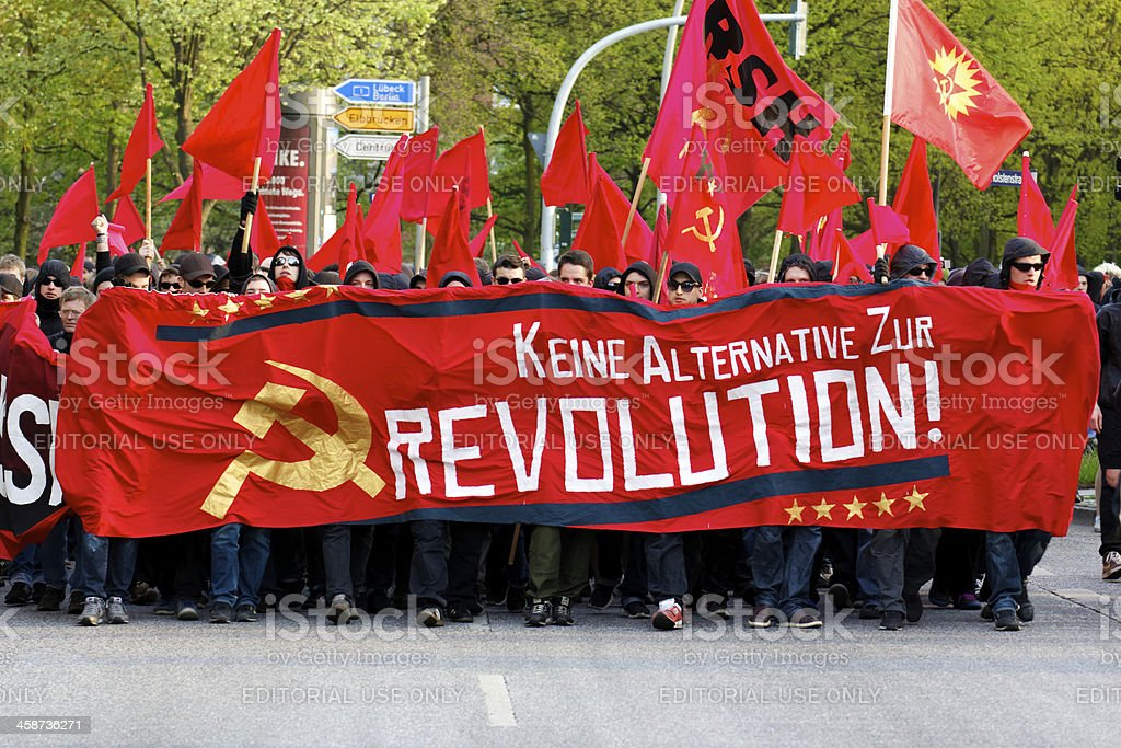 Protesters March with Red Banners royalty-free stock photo