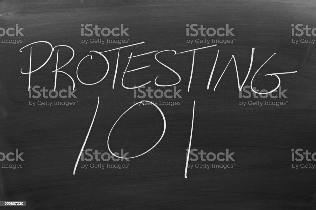 Protesting 101 On A Blackboard stock photo