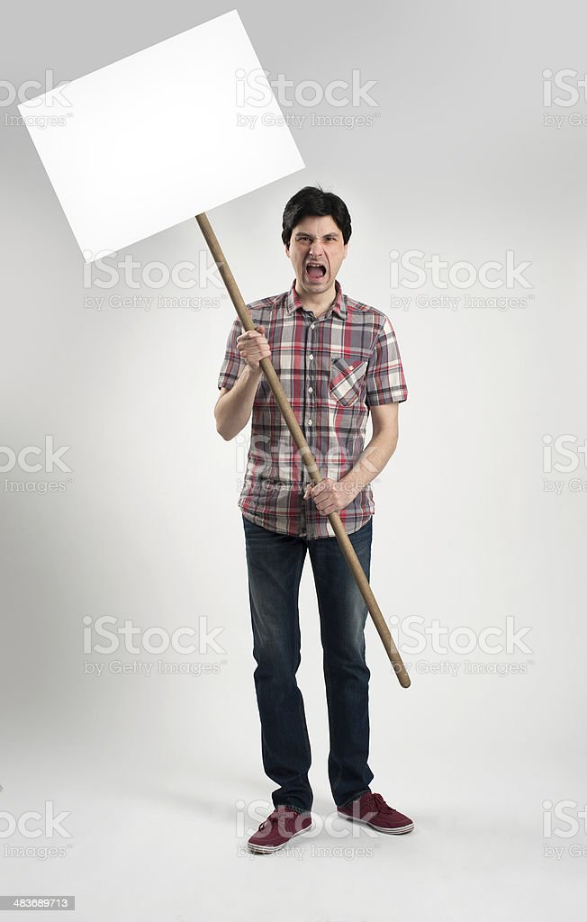 Protesting man with placard stock photo