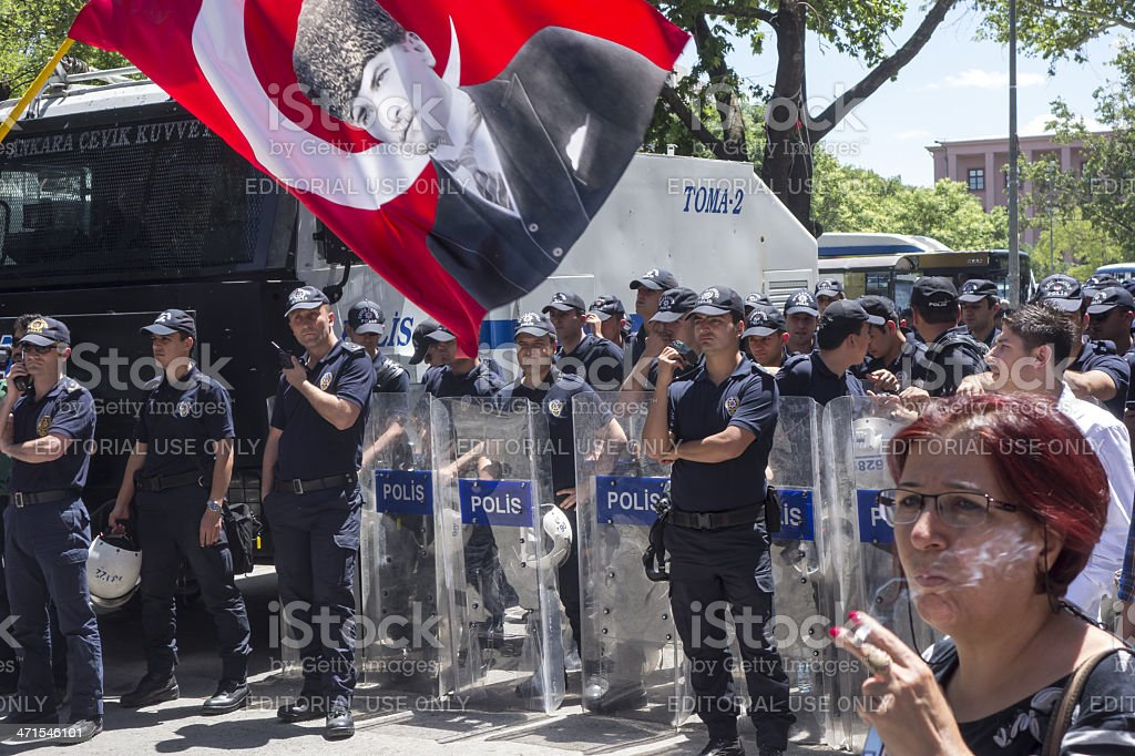 Protestor is shaking Turkish Flag against the Police stock photo