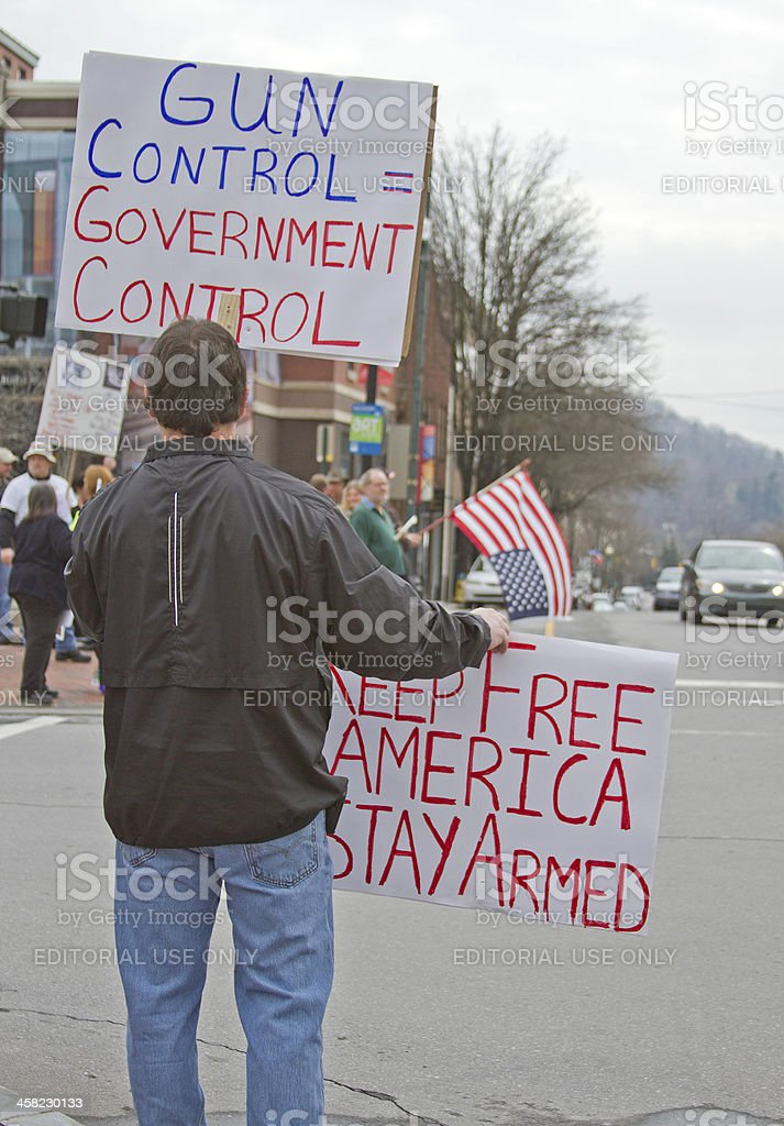 Protestor Shows Gun Control Signs to Passers By in Asheville stock photo