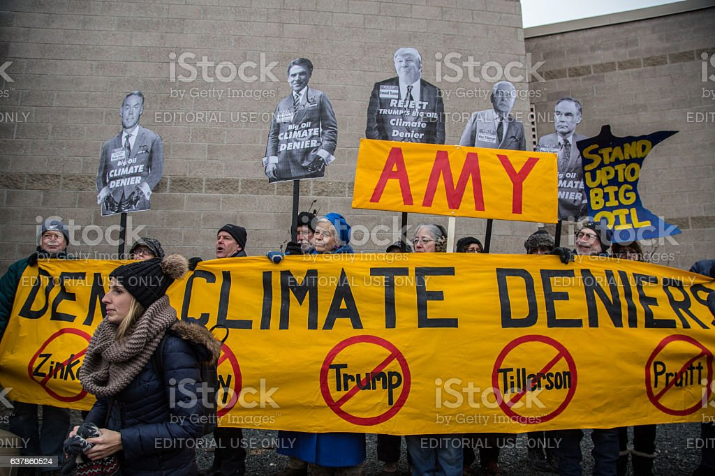 Protestors Hold a Banner at Amy Klobuchar's Office stock photo