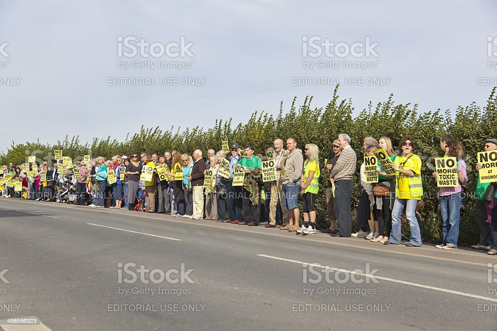 Protestors holding placards against toxic waste processing in En stock photo