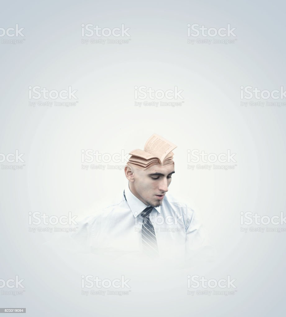 Protrait of a man with a book in top of his head, stock photo