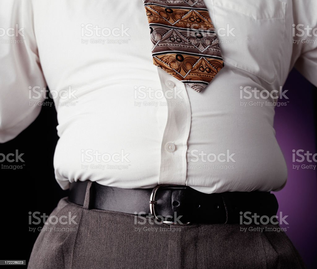 Protruding waistline, common within the middle aged man stock photo