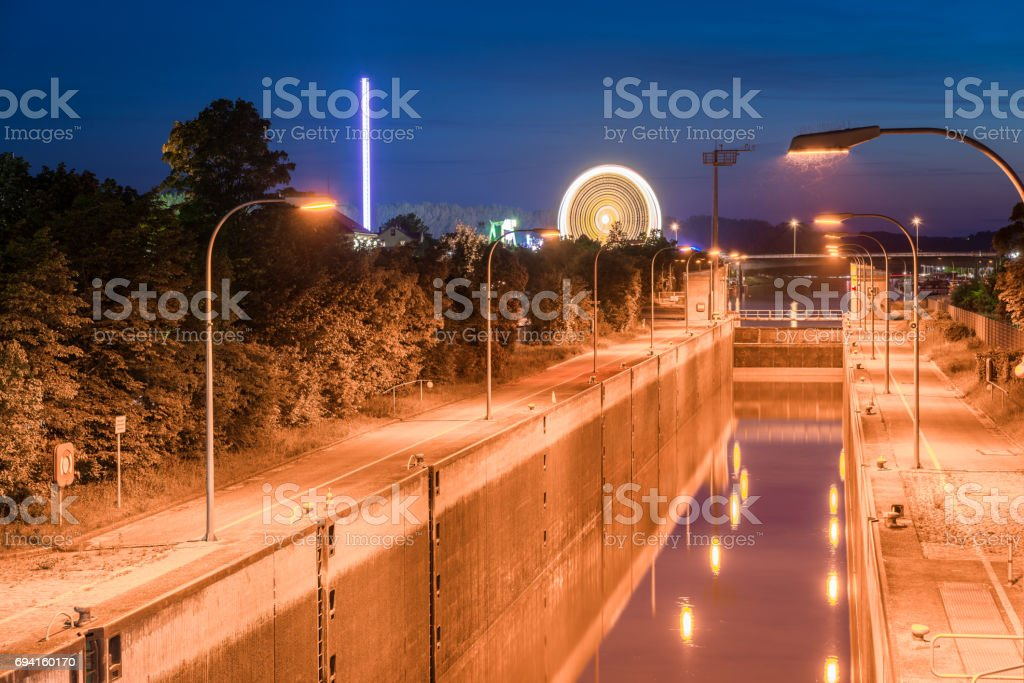 Protzenweiher bridge and Watergate of the Europa canal in Regensburg during the maidult folk festival stock photo