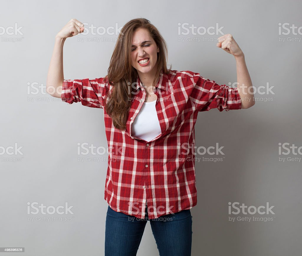 proud 20s woman screaming out loud her independance and gender stock photo