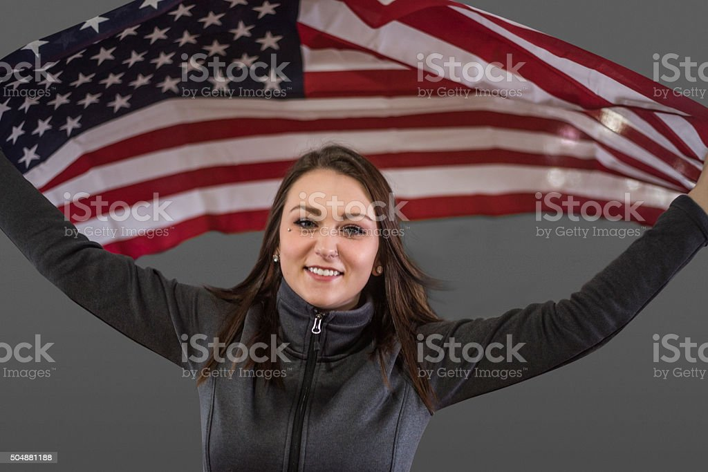 Proud American olympic athelete with United States flag stock photo