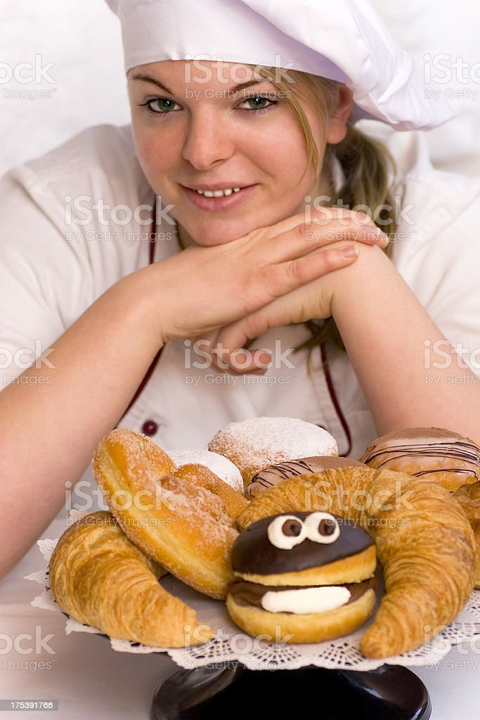 Proud Baker with sweet pastry goods royalty-free stock photo