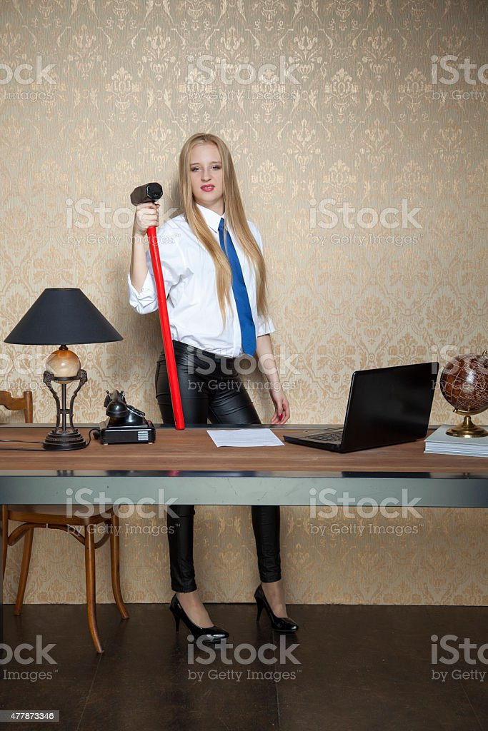 proud business woman with a big hammer stock photo