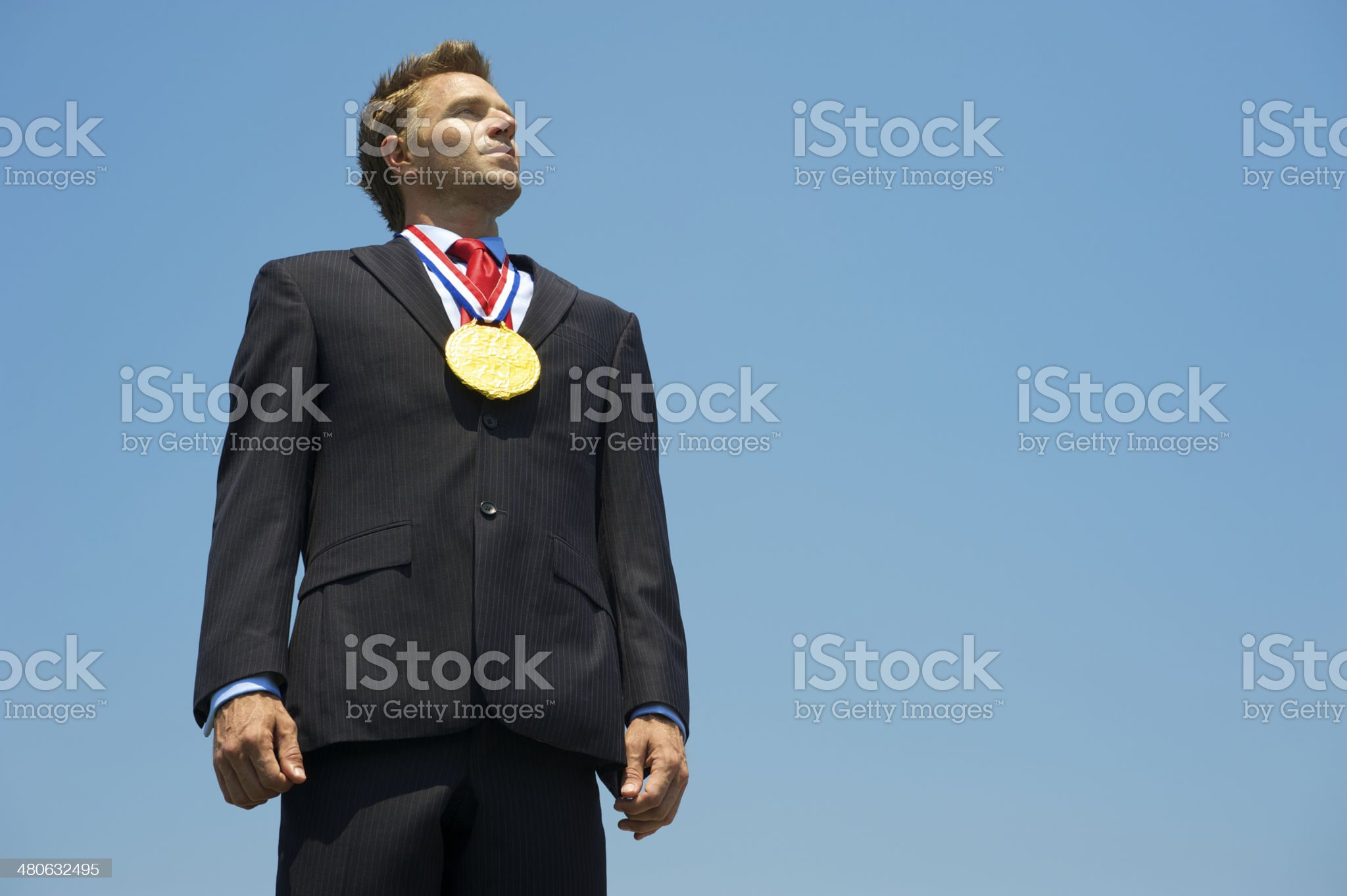Proud Businessman Stands with Gold Medal royalty-free stock photo