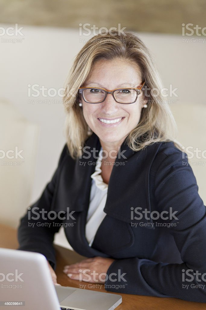 Proud Businesswoman At Home Office Using Laptop stock photo