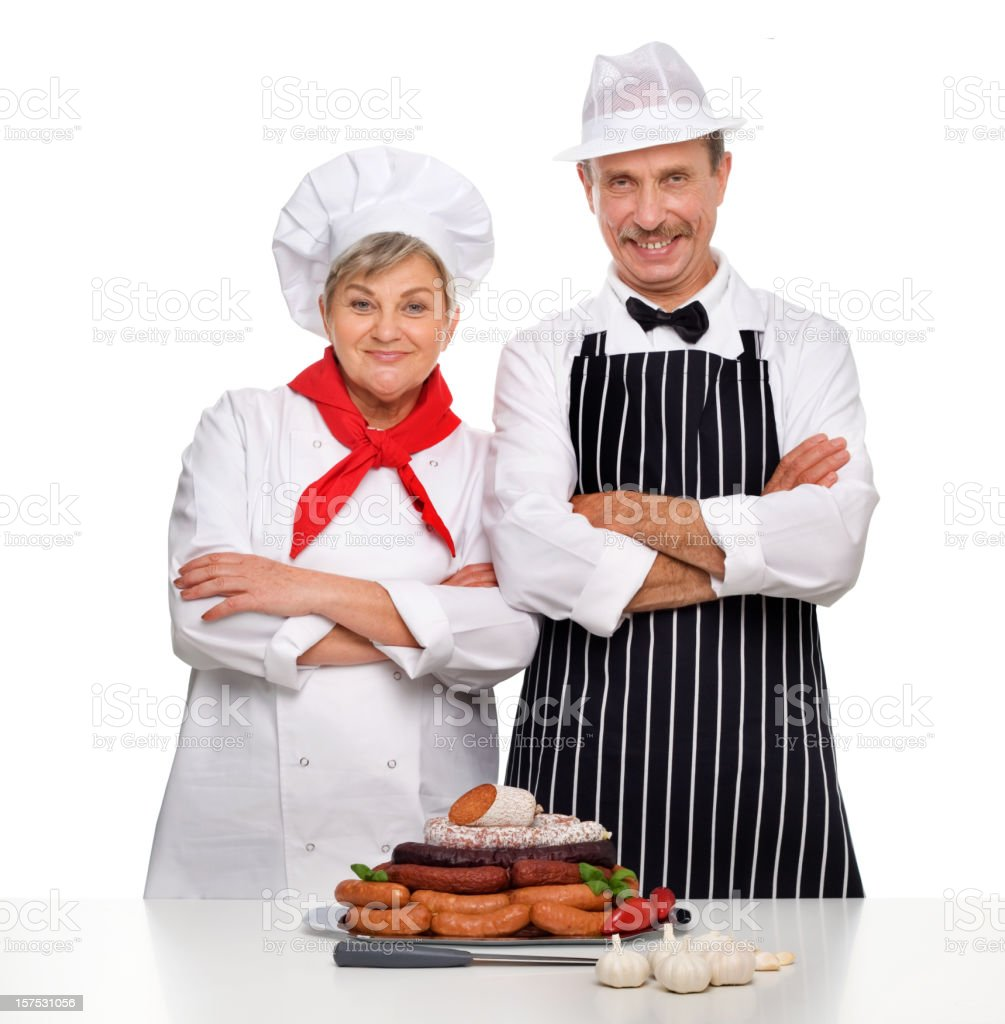 Proud Butchers With Variety Of Sausages royalty-free stock photo