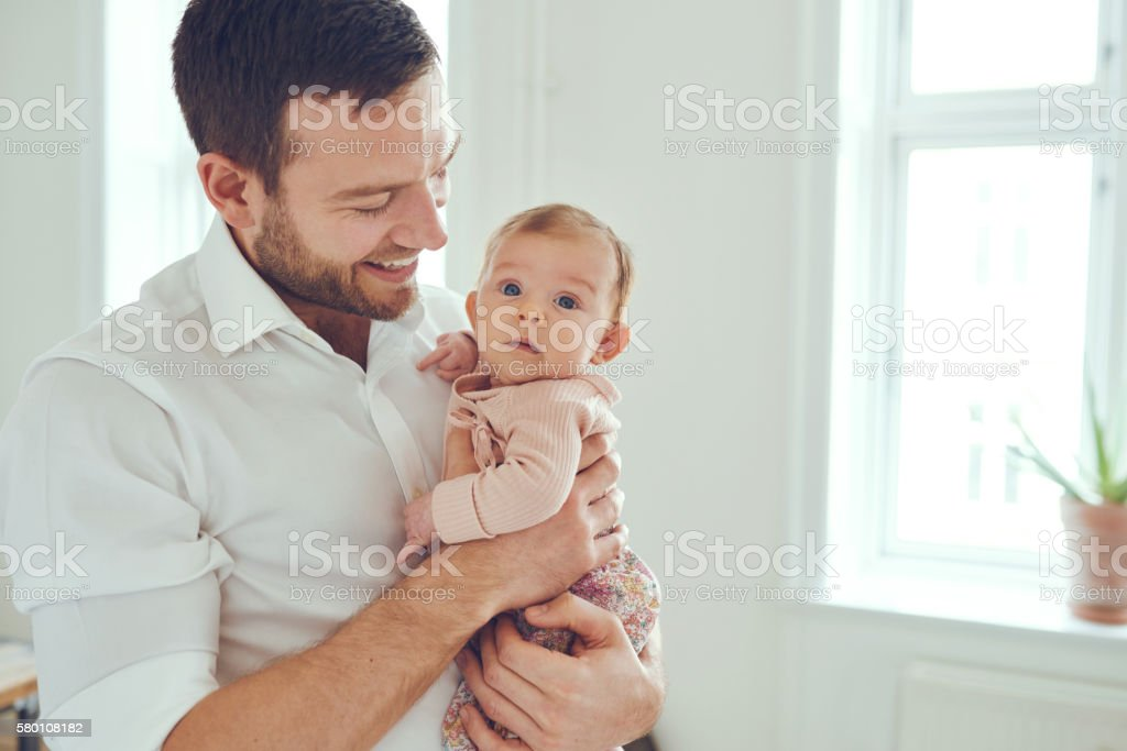 Proud father of a little baby girl stock photo