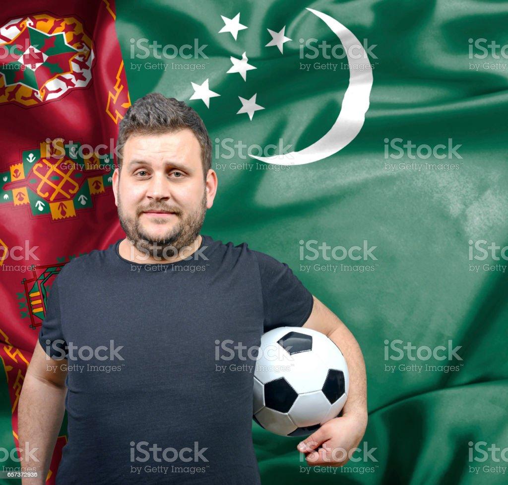Proud football fan of Turkmenistan stock photo