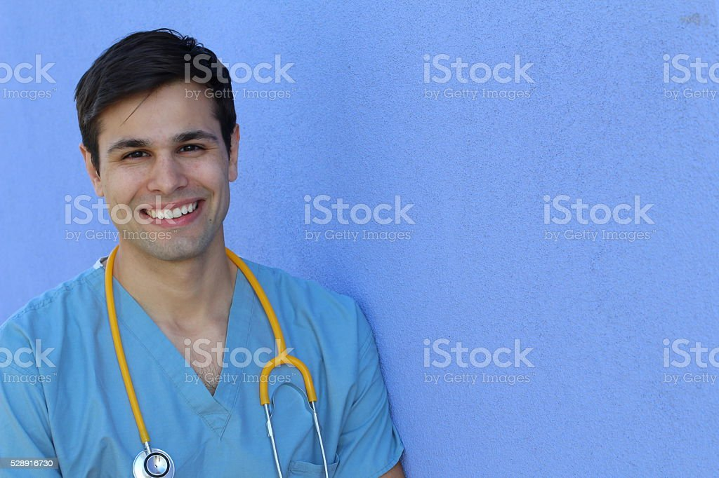 Proud handsome young nurse student smiling stock photo