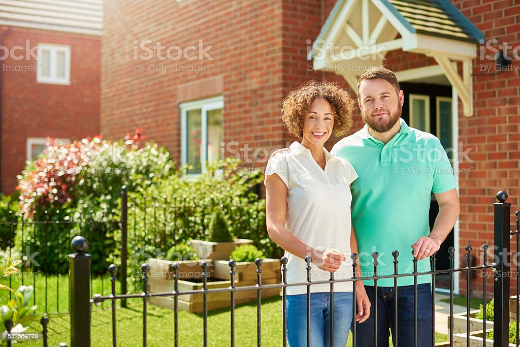 proud homeowner couple stock photo