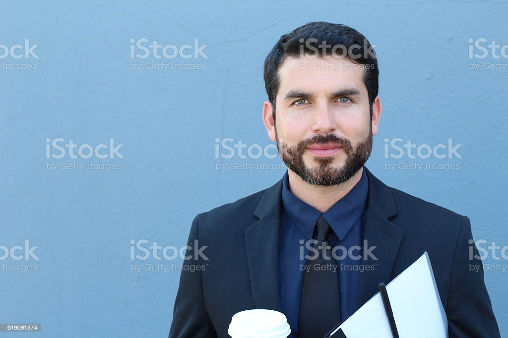 Proud Italian Businessman smiling with copyspace stock photo