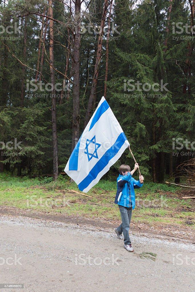 Proud Jewish boy with an Israeli flag stock photo