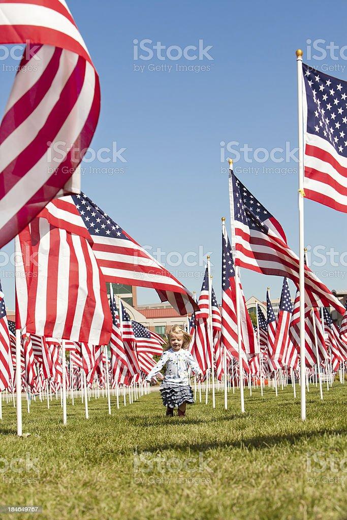Proud little girl with American Flags Utah stock photo