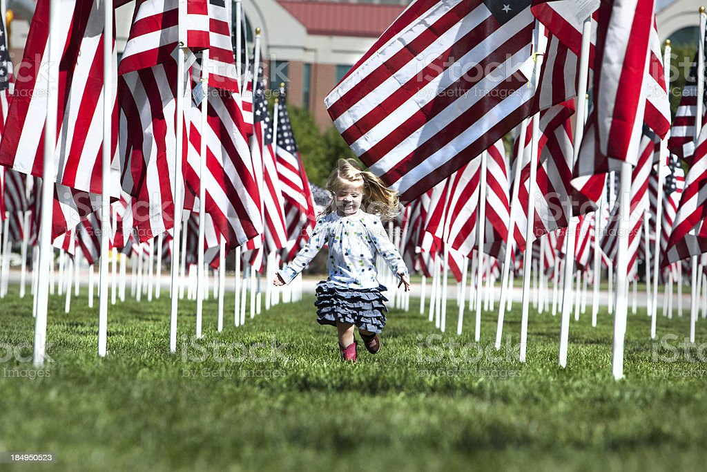 Proud little girl with American Flags Utah stock photo