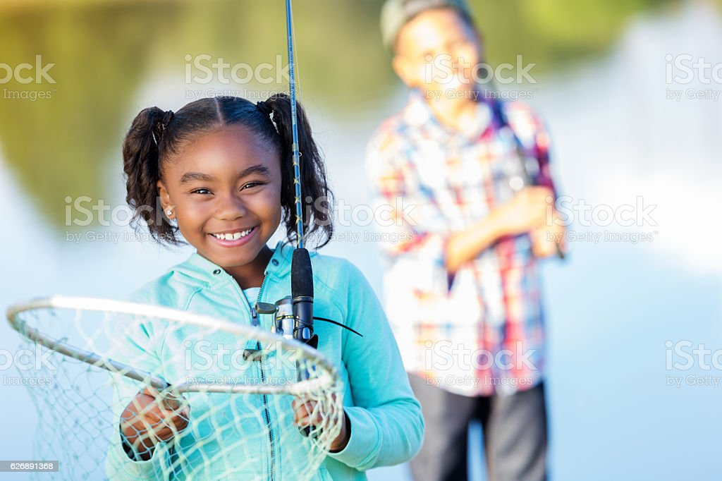 Proud little girl with fishing net stock photo