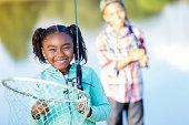 Proud little girl with fishing net