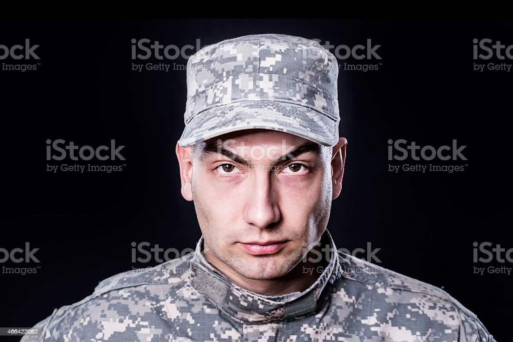 Proud male army soldier on black background stock photo