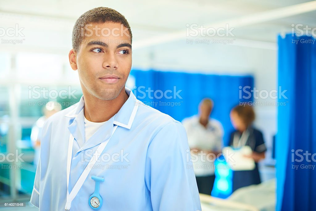 proud male nurse stock photo
