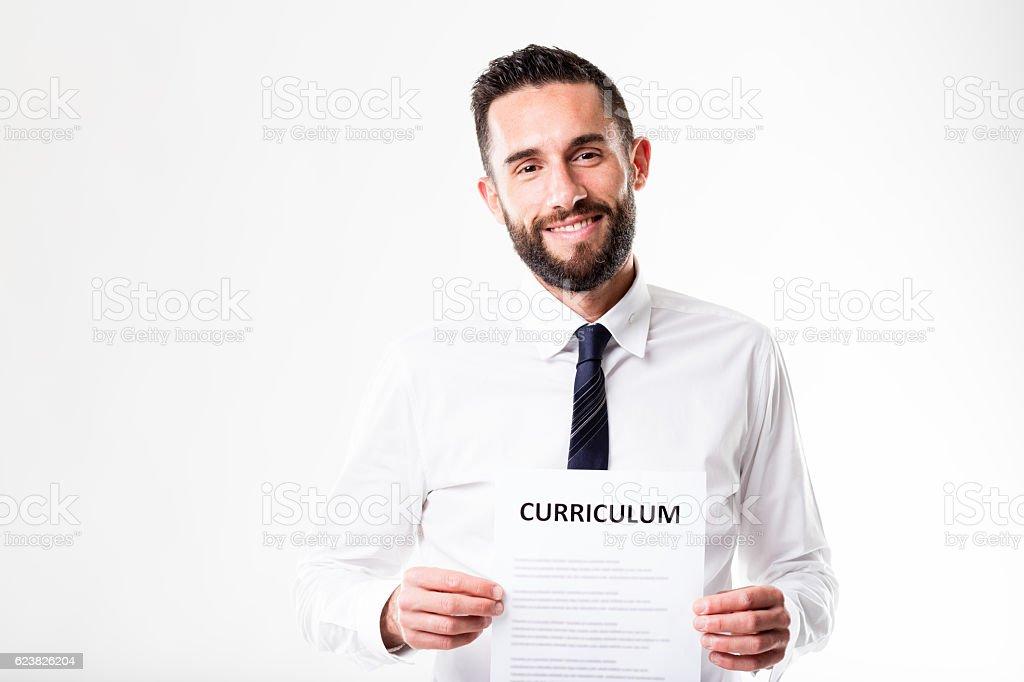 proud man showing his worthwhile resume stock photo