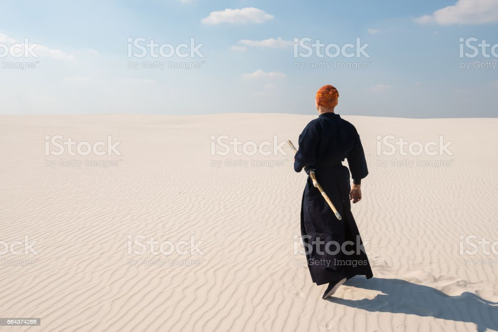 Proud man, warrior walks through the wilderness into the distance stock photo