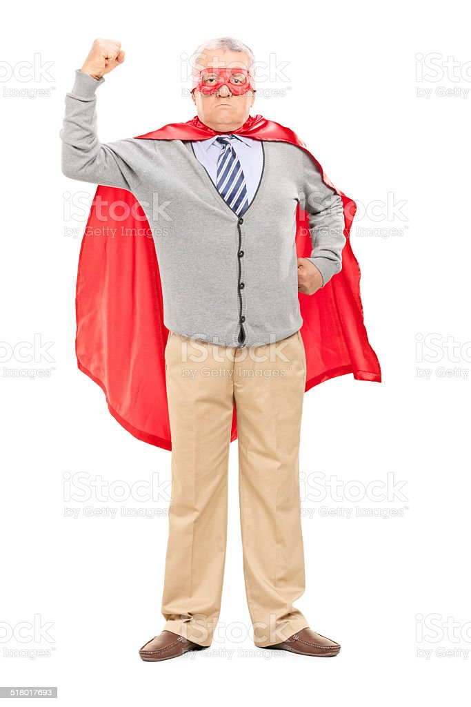 Proud mature man in superhero costume stock photo