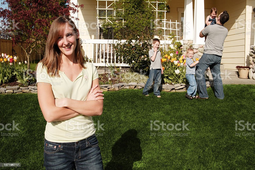 Proud Mother arms crossed at home with her family royalty-free stock photo
