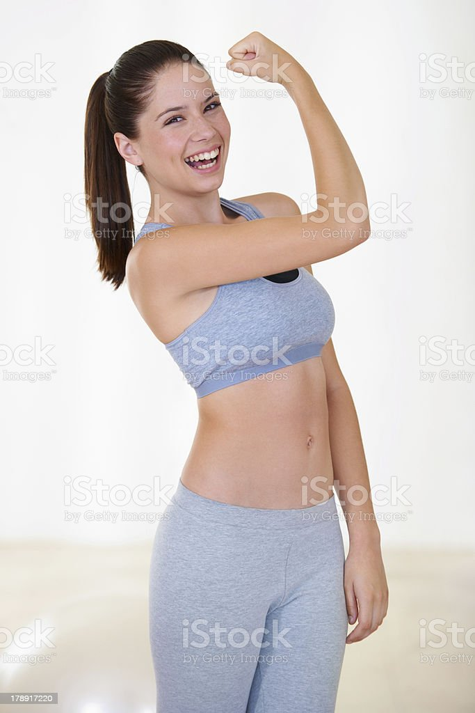 Proud of her biceps royalty-free stock photo