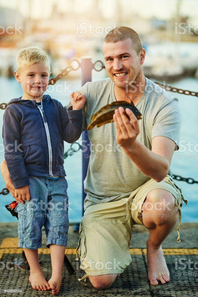 Proud of his boy's first catch stock photo