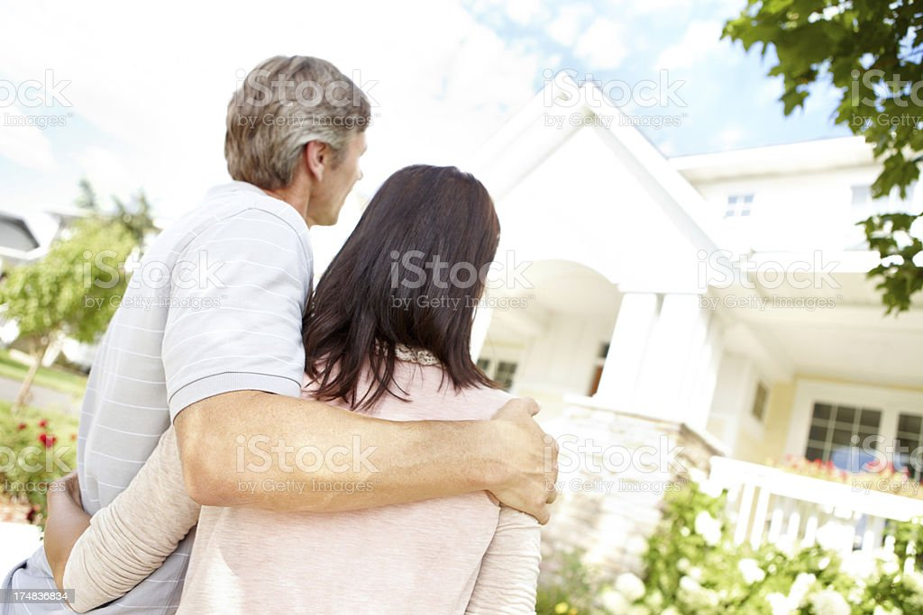 Proud of their beautiful home royalty-free stock photo