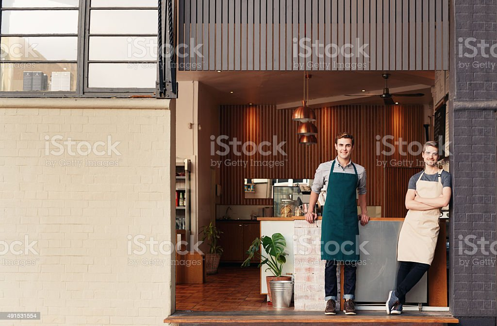Proud of their little coffee shop stock photo