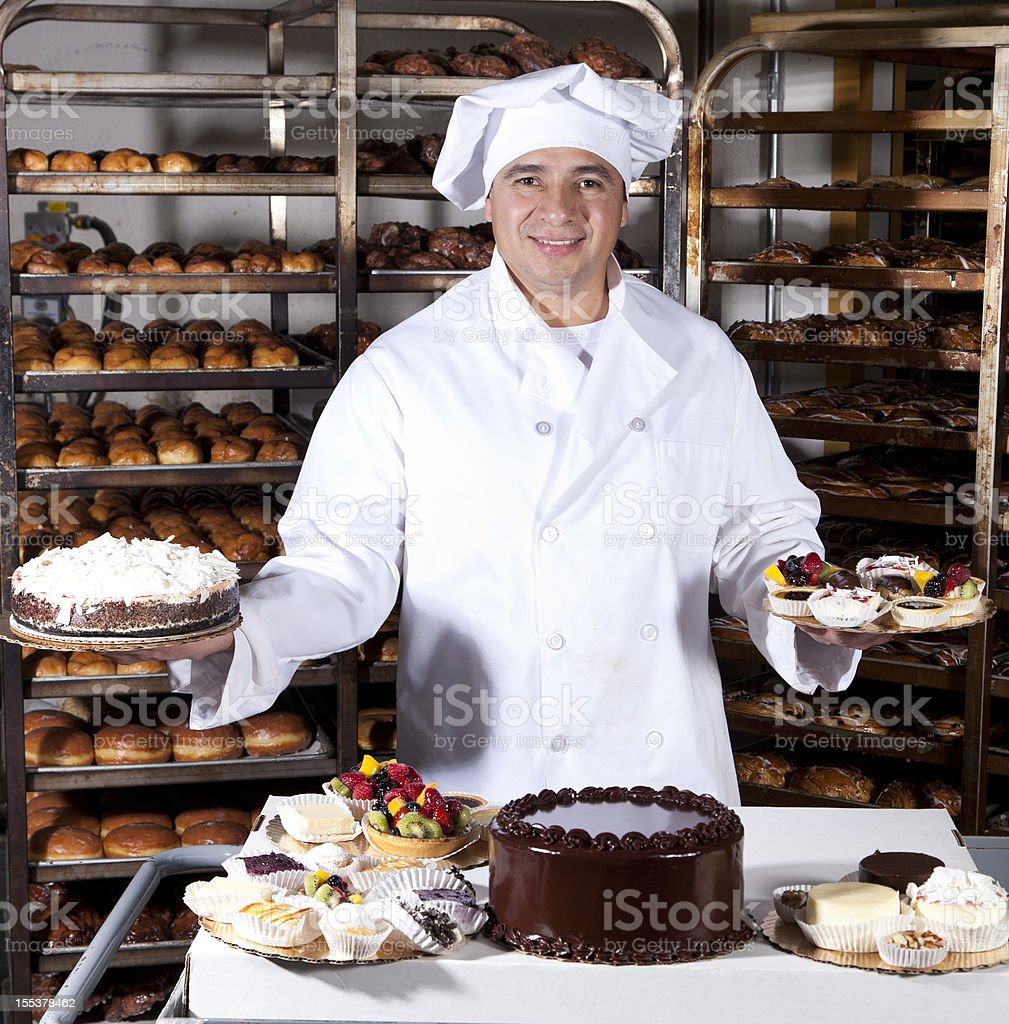 proud owner of small bakery royalty-free stock photo