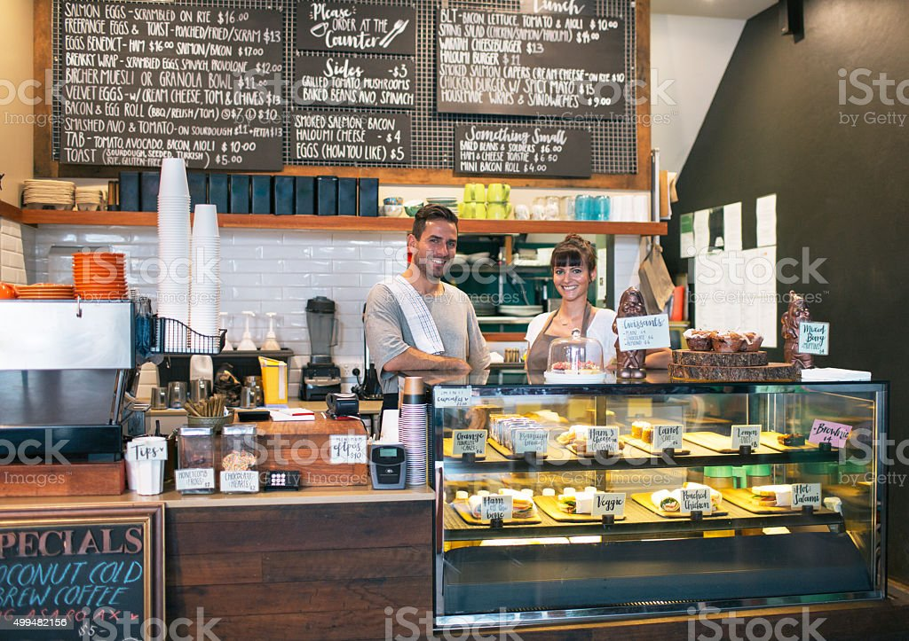 Proud owners of coffee bar stock photo