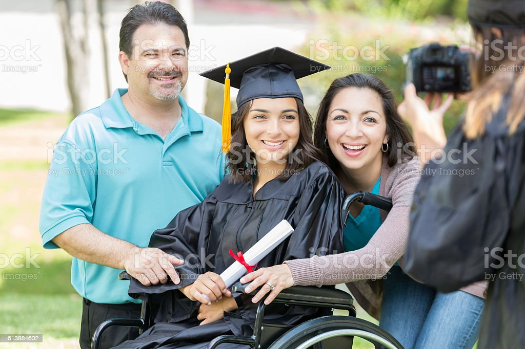 Proud parents with college graduate stock photo