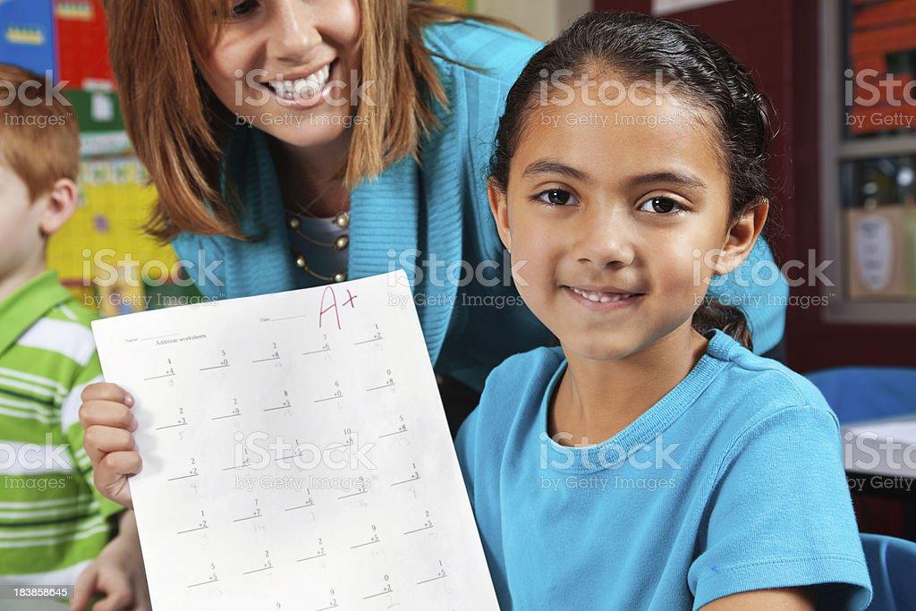Proud School Girl Showing Her Good Grade stock photo