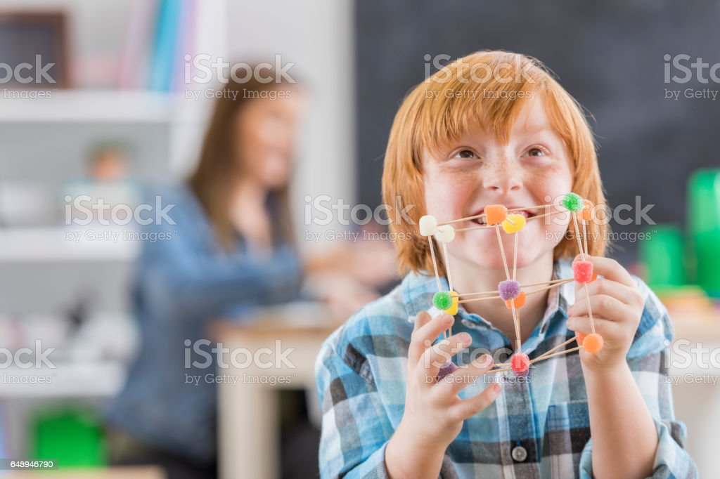 Proud schoolboy with engineering project stock photo