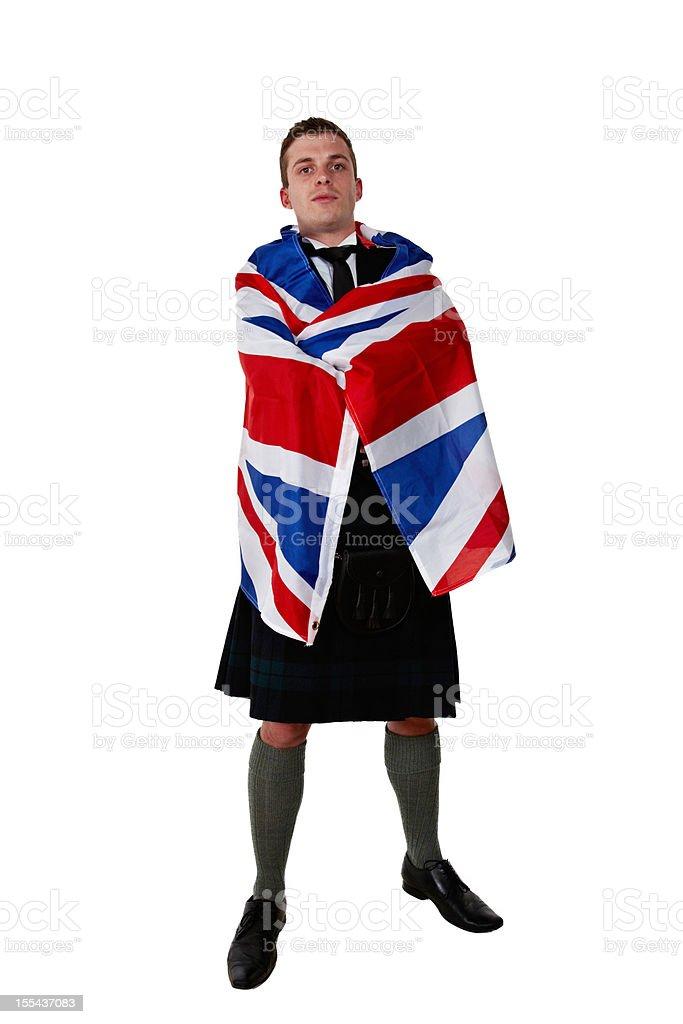 Proud scotsman wearing kilt wrapped in Union Jack stock photo