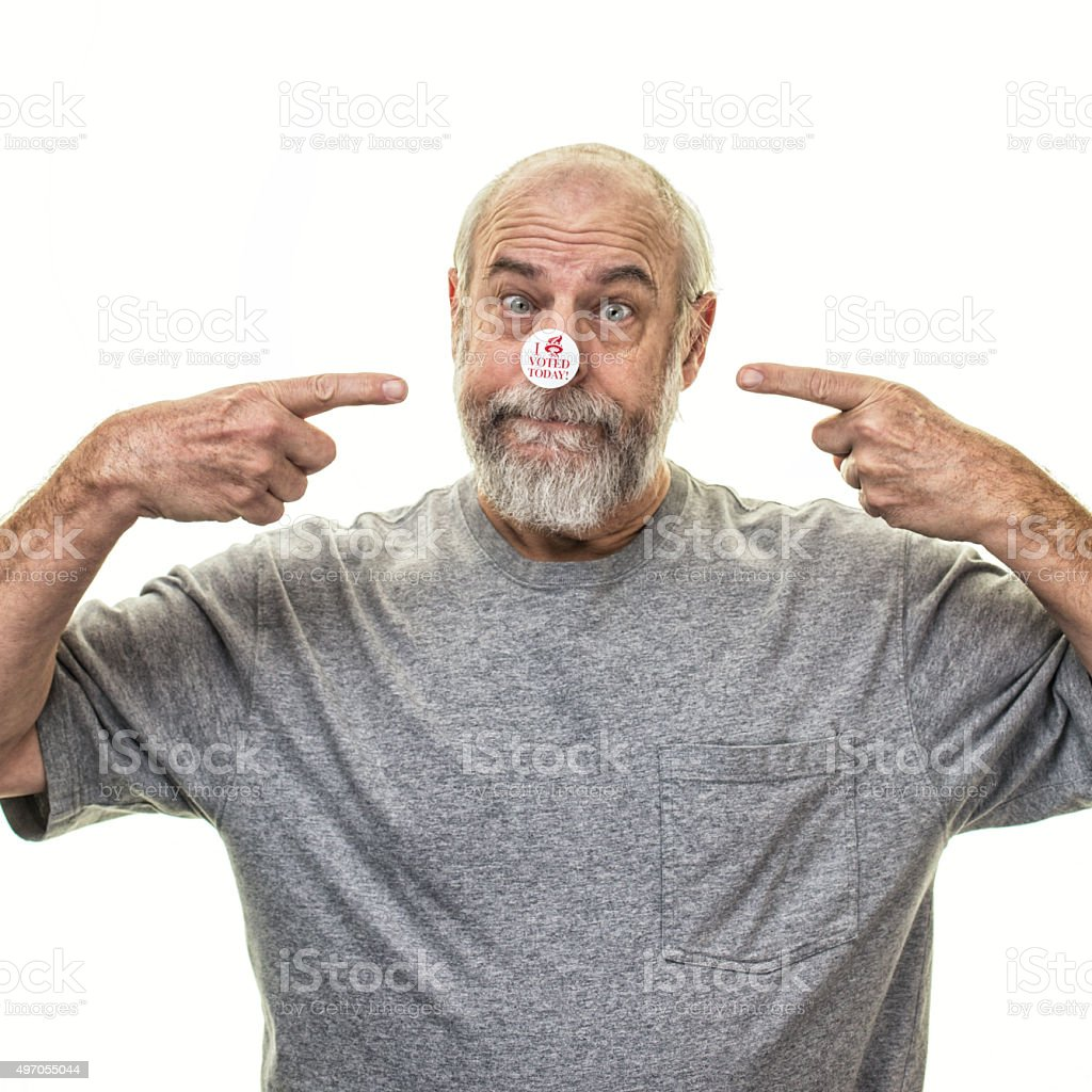 Proud Senior Man Voter Pointing Fingers At Nose Voting Sticker stock photo