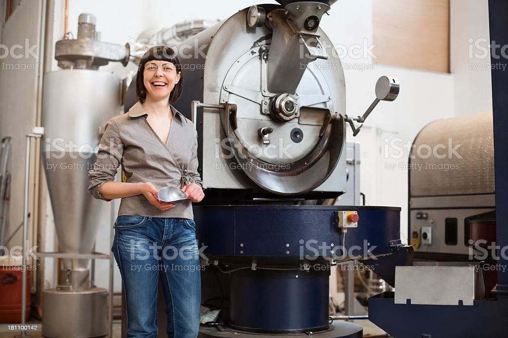 Proud small business owner at a coffee roaster royalty-free stock photo