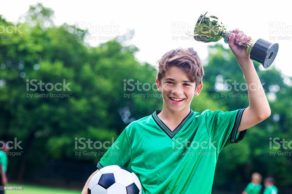 Proud soccer champ with trophy stock photo