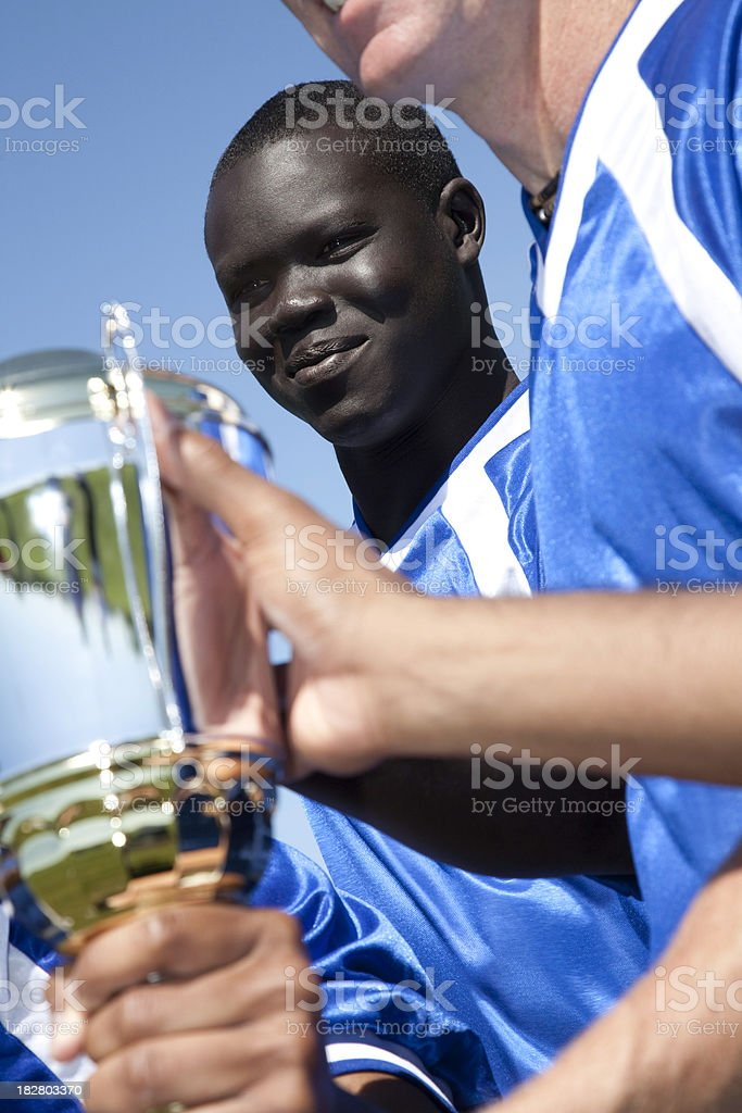 Proud Soccer Players Holding Team Championship Trophy royalty-free stock photo